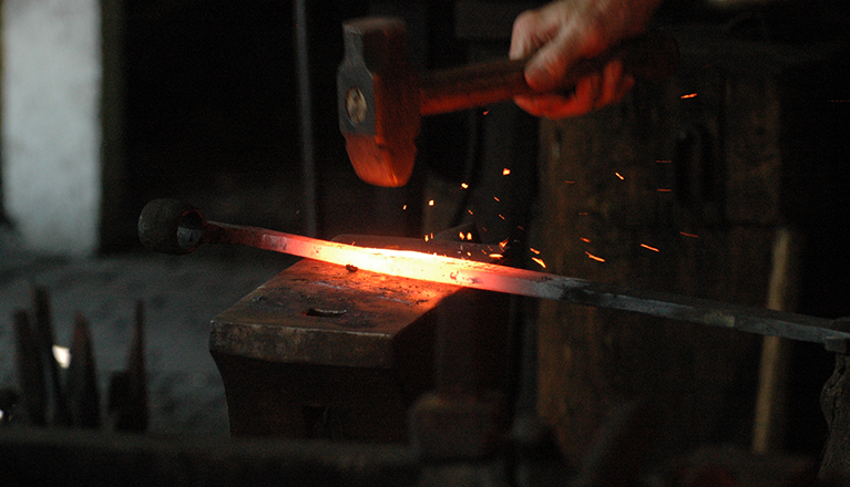 Hammer and blade in a blacksmiths